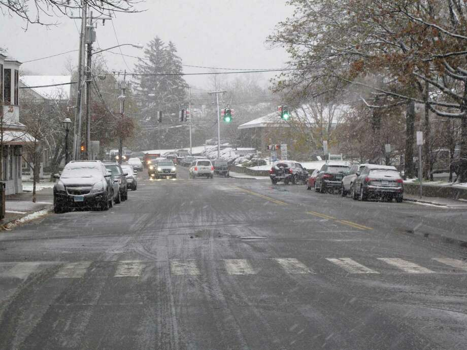 New Canaan, Conn. sees its first snowfall of the year on Nov. 7, 2012. Park Street. Photo: Tyler Woods
