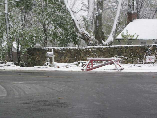 Barriers left over from Hurricane Sandy are engulfed in snow on Weed Street in New Canaan, Conn. Nov. 7, 2012. Photo: Tyler Woods