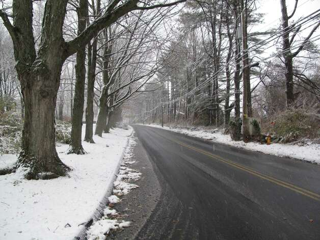 New Canaan, Conn. sees its first snowfall of the year on Nov. 7, 2012. Weed Street. Photo: Tyler Woods