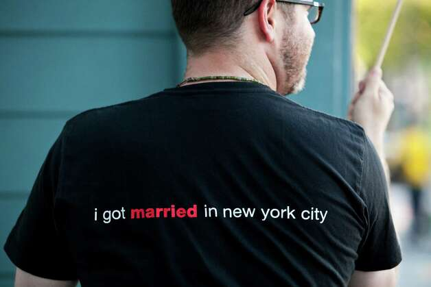 Allows gay marriage: New YorkBrandon Brock wears a shirt commemorating his marriage to his partner in New York City during a rally celebrating Obama's announcement that he supports gay marriage at the San Francisco Lesbian Gay Bisexual Transgender Community Center in San Francisco, Calif., May 9, 2012. 