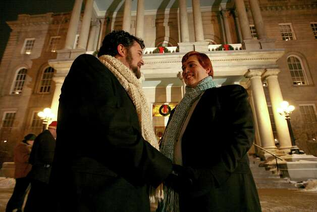 Allows gay marriage: New HampshireIn this Jan. 1, 2010 file photo, Bill Gaudet, left, and Ramon Gaudet, right, wait to be wed in front of New Hampshire's Statehouse  in Concord, N.H., as the Marriage Equality law, permitting gay marriage, took effect a few minutes earlier at midnight.  (AP Photo/Cheryl Senter, File) Photo: Cheryl Senter, Associated Press / AP2010