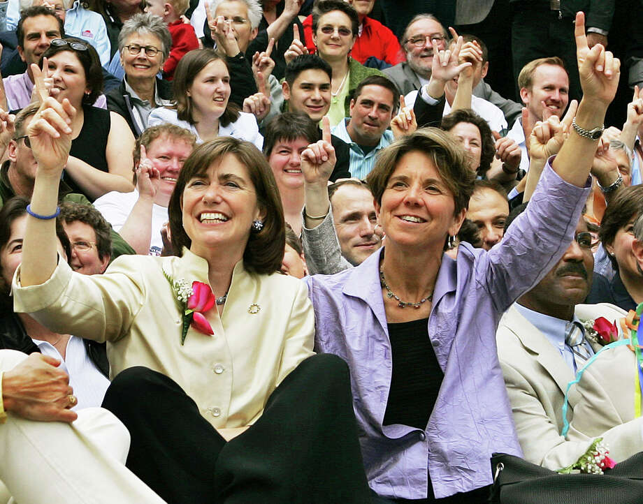 Allows gay marriage: MassachusettsIn this May 17, 2005, file photo, Julie, front left, and Hillary Goodridge pose with other gay couples and supporters as they celebrate their first wedding anniversary in Boston. The couple led the legal fight for Massachusetts to become the first state to legalize same-sex marriages. Photo: Elise Amendola, AP / AP