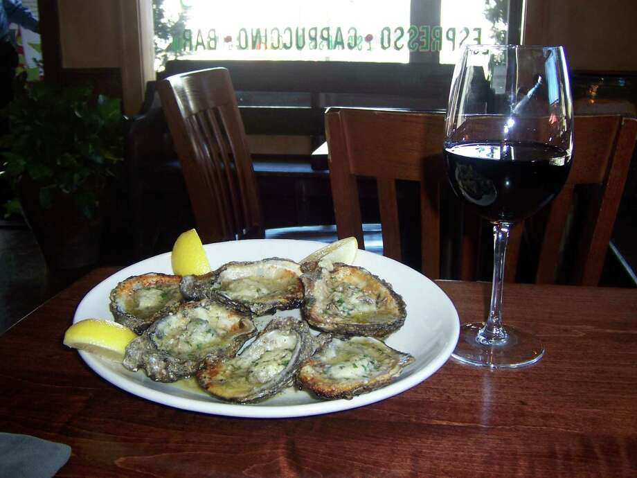 Grappino's offers a half-dozen oysters - on the half shell or char-broiled - and a glass of wine for $12 every Monday. Photo: Courtesy Photo