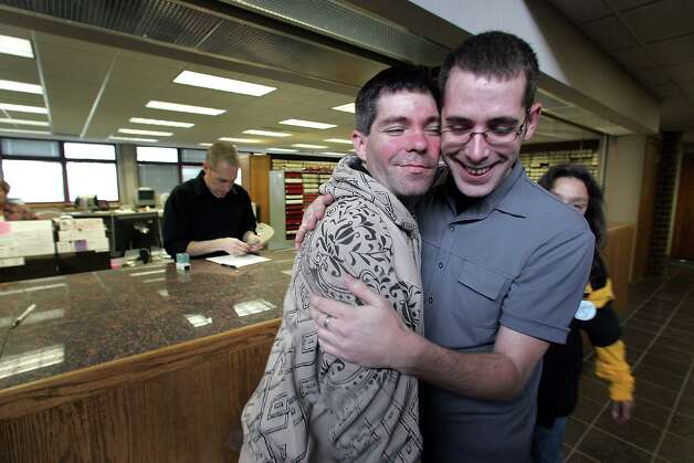Allows gay marriage: IowaDavid Wise, left, and Sean Casey of Coralville, Iowa embrace after filing to receive a marriage license Monday, April 27, 2009 at the Johnson County Administration Building in Iowa City, Iowa. It was the first day same sex couples were able to file for marriage licenses in Iowa.  (AP Photo/The Gazette, Brian Ray)  Photo: BRIAN RAY, AP / THE GAZETTE