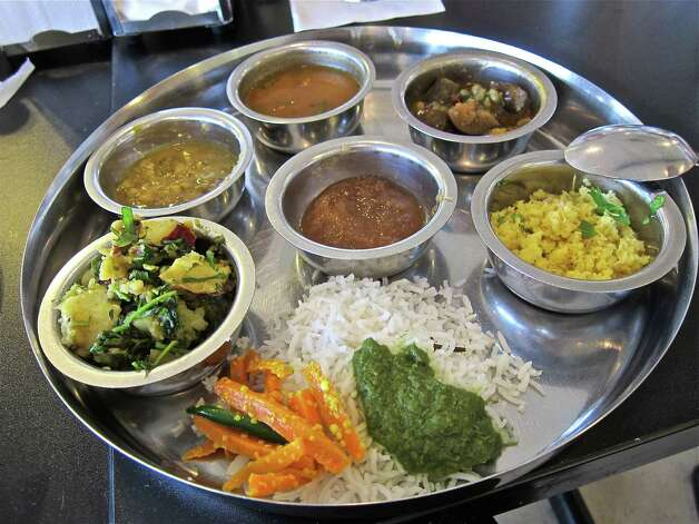 Vishala's Gujarati thali-style lunch buffet allows diners to customize the meal with a variety of curries, broths and condiments. Photo: Alison Cook