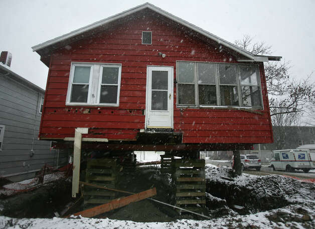 Snows from the nor'easter fall on a storm damaged home, in the process of being raised in the wake of Hurricane Sandy, in the Point Beach neighborhood in Milford on Wednesday, November 7, 2012. Photo: Brian A. Pounds / Connecticut Post