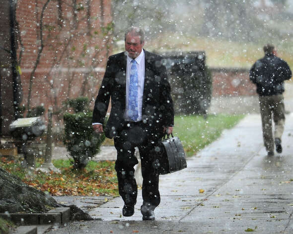 Bridgeport lawyer Edward J. Gavin walks through the snowflakes to his car outside Superior Court in Milford on Wednesday, November 7, 2012. Photo: Brian A. Pounds / Connecticut Post