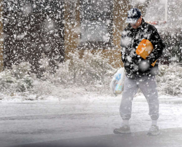 A man is almost obscured by the driving snow on White Street in Danbury, Wednesday afternoon, Nov. 7, 2012. Photo: Carol Kaliff / The News-Times