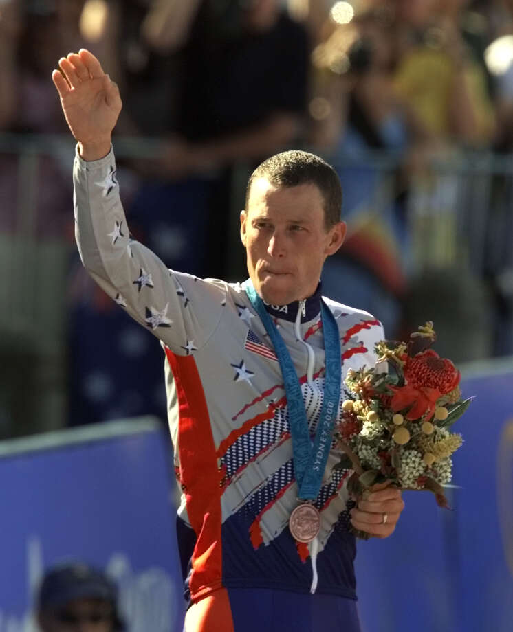 FILE - In a Sept. 30, 2000 file photo, U.S. cyclist Lance Armstrong waves after receiving the bronze medal in the men's individual time trials at the 2000 Summer Olympics cycling road course in Sydney, Australia. The IOC formally opened an investigation Thursday, Nov. 1, 2012, that could result in Lance Armstrong being stripped of his Olympic bronze medal for doping. (AP Photo/Ricardo Mazalan, File) Photo: RICARDO MAZALAN