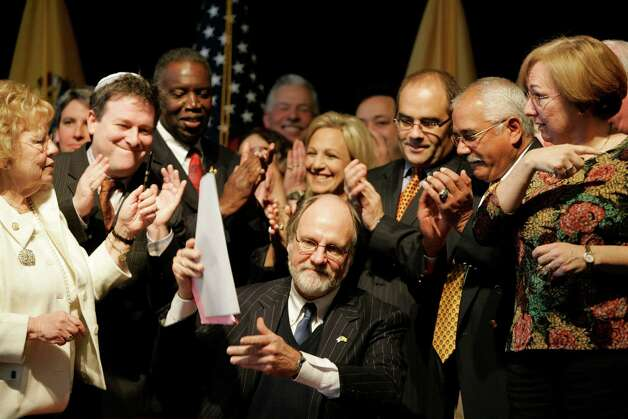 Allows civil unions: New JerseyFormer New Jersey Gov. Jon Corzine, center, surrounded by state legislators and gay rights advocates, holds up the civil unions legislation he just signed during a ceremony in Trenton, N.J., Thursday, Dec. 21, 2006. The New Jersey legislature approved a freedom to marry bill in 2012, but it was vetoed by Gov. Chris Christie. There is a movement under way to override the veto, according to freedomtomarry.org. Photo: Mike Derer, AP / AP