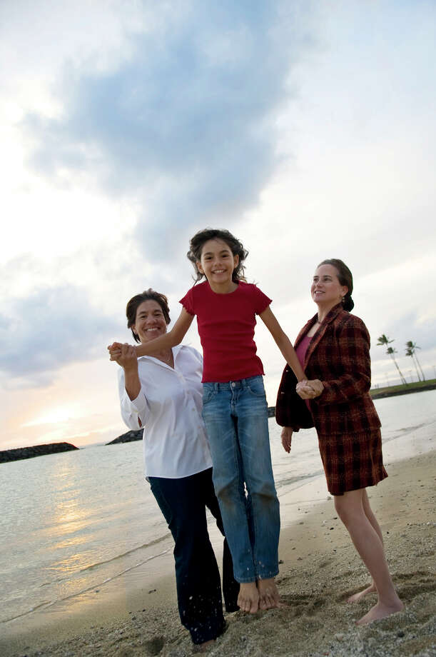 Allows civil unions: HawaiiFrom right, Suzanne King, Shylar Young, 9 and Tambry Young all of Honolulu walk along the shore at Ala Moana Park in Honolulu, Hawaii, Thursday, Feb. 19, 2009. A civil unions measure presented in 2009 did not pass, but the state later passed a similar bill that took effect on Jan. 1, 2012.  Photo: Lucy Pemoni, AP / FR58940 AP