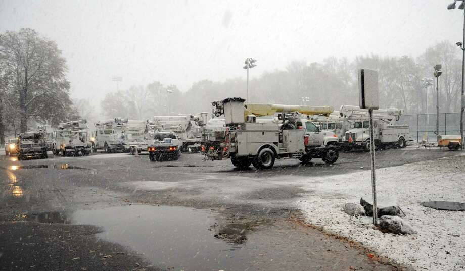 Utility trucks gather at Scalzi Park in Stamford as they prepare to react to possible damage from a nor'easter on Wednesday, November 7, 2012. Photo: Lindsay Niegelberg / Stamford Advocate