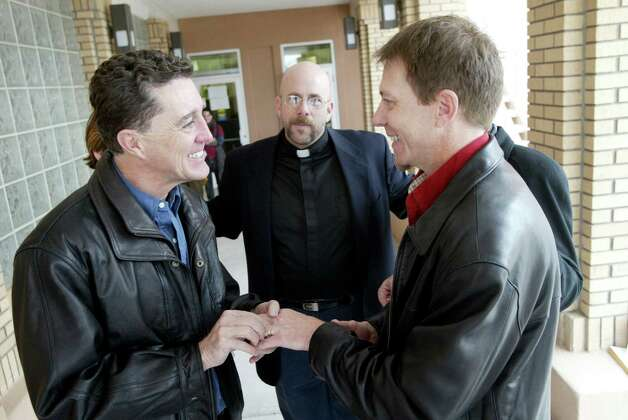 Recognizes gay marriages from other states: New MexicoJames Walker places a ring on his partner, Michael Palmer, while trading vows under the direction of Rev. David Gant, center, Friday afternoon, Feb. 20, 2004, in the back of the Sandoval County Court House in Bernalillo, N.M. Sandoval County started issuing marriage licenses to same sex couples that morning after the county's attorney  deemed that New Mexico law was not clear and that refusing to issue the licenses to same-sex couples could open the county to legal liability. The New Mexico attorney general quickly put a stop to the issuance of marriage licenses in the state, but New Mexico still recognizes same-sex marriages from out of state. Photo: RICK SCIBELLI, AP / AP