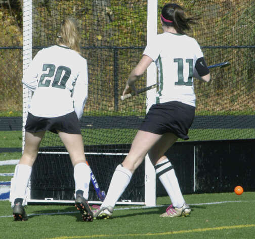 Olivia Monteiro (11) and Taylor Duffany (20) of the Green Wave poise before celebrating Olivia's goal during New Milford High School field hockey's 3-1 victory over Joel Barlow in the South-West Conference playoff semifinals at Immaculate High in Danbury. Nov. 4, 2012 Photo: Norm Cummings