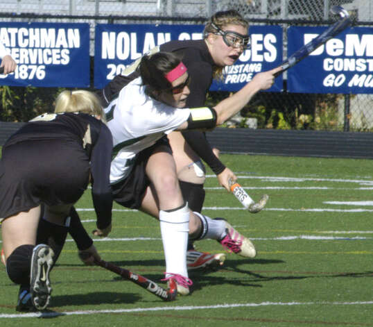 Olivia Monteiro of the Green Wave follows through on her smash on goal  that resulted in NMHS' second goal during New Milford High School field hockey's 3-1 victory over Joel Barlow in the South-West Conference playoff semifinals at Immaculate High in Danbury. Nov. 4, 2012 Photo: Norm Cummings