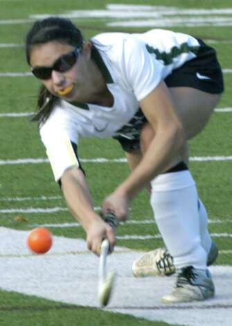 The Green Wave's Vienna Pallisco sets up a teammate for a rush on goal during New Milford High School field hockey's 3-1 victory over Joel Barlow in the South-West Conference playoff semifinals at Immaculate High in Danbury. Nov. 4, 2012 Photo: Norm Cummings