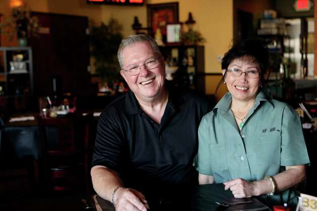 KevinGary and Hua Clarke, owners of Aw Dang Restaurant in Schertz have owned the restaurant for six years. Photo: Helen L. Montoya, San Antonio Express-News / ©SAN ANTONIO EXPRESS-NEWS