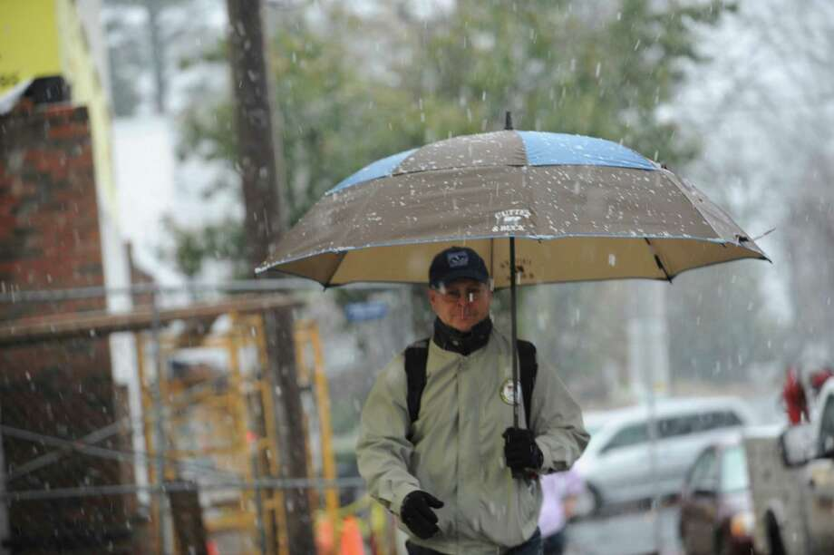 Bob MacAlpine, a teacher at Old Greenwich School, on his way to the train on Sound Beach Avenue in Old Greenwich, Conn. Wednesday, Nov. 7, 2012, during the Nor'easter. Photo: Helen Neafsey / Greenwich Time