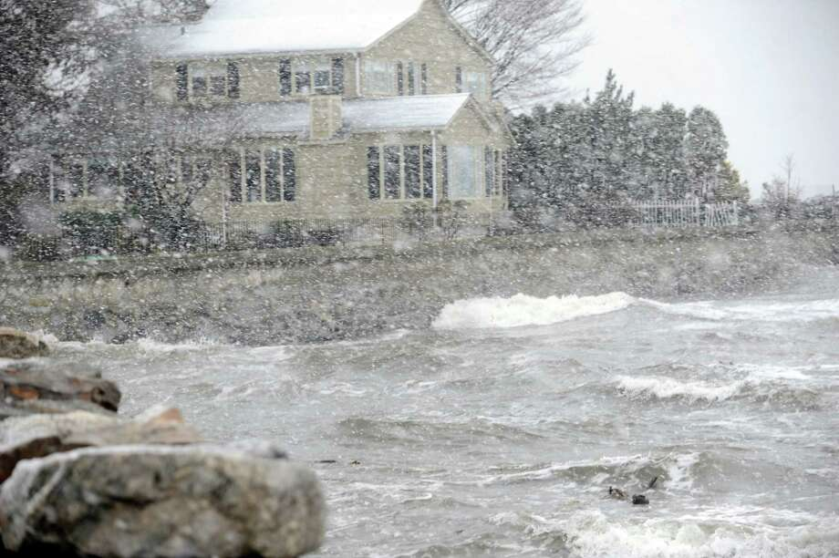 A house on Shore Road in Old Greenwich in Conn., Wednesday, Nov. 7, 2012, during the Nor'easter. Photo: Helen Neafsey / Greenwich Time