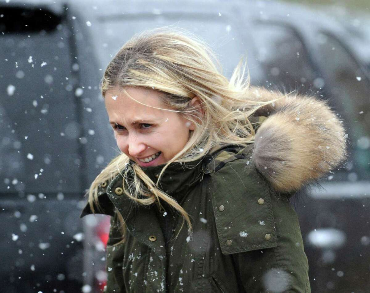 Regina Fedotov of Greenwich has the hood of her coat blown back by the wind while walking on Mason Street in the driving snow during the nor'easter that hit Greenwich, Wednesday, November 7, 2012.
