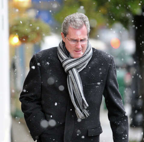 "Xavier Thomas who works in Greenwich, wears a scarf as he heads up Greenwich Avenue during the nor'easter that hit town, Wednesday, November 7, 2012. When asked to comment about the storm, Thomas said, ""I like the snow."" Photo: Bob Luckey / Greenwich Time"