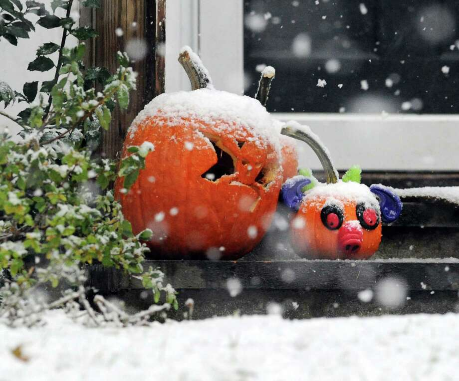 Two snow-covered Jack-o-lanterns on the front steps of a Terrace Avenue home in Riverside during the nor'easter that hit town, Wednesday, November 7, 2012. Photo: Bob Luckey / Greenwich Time