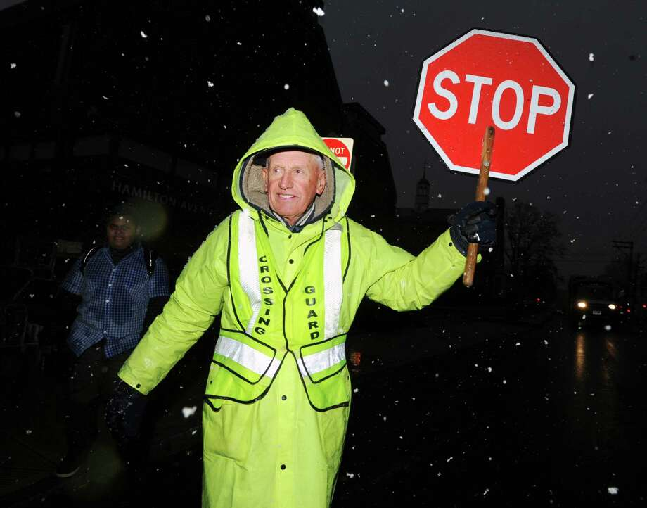 Crossing guard John Zmarzlak helps a Hamilton Avenue School student cross St. Roch Avenue in Byram during the nor'easter that hit town, Wednesday, November 7, 2012. Photo: Bob Luckey / Greenwich Time