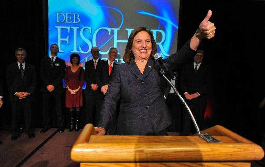 Nebraska Rep. Deb Fischer gives her supporters a thumbs up at a post-election party Tuesday. (AP Photo/Dave Weaver)