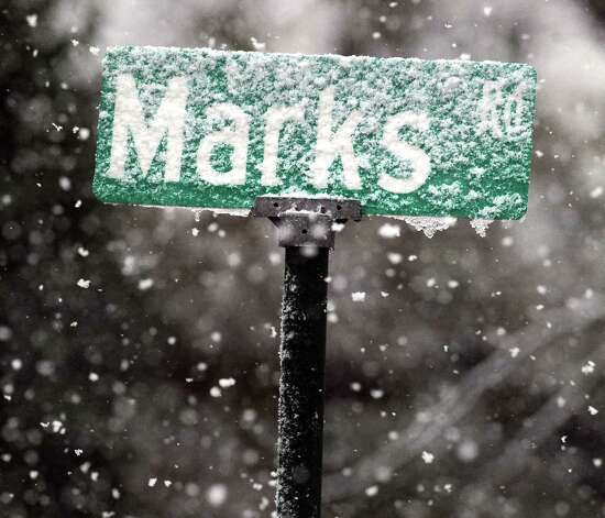 A snow-covered Marks Road sign in Riverisde during the nor'easter that hit Greenwich, Wednesday, November 7, 2012. Photo: Bob Luckey / Greenwich Time