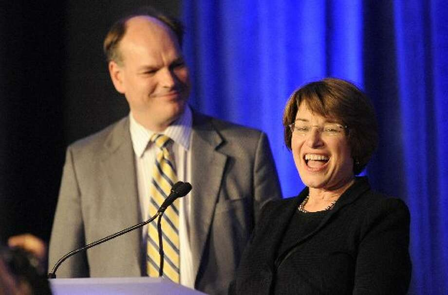 U.S. Senator from Minnesota Amy Klobuchar speaks at an election night event with husband after winning re-election. (AP  Photo/Hannah Foslien)