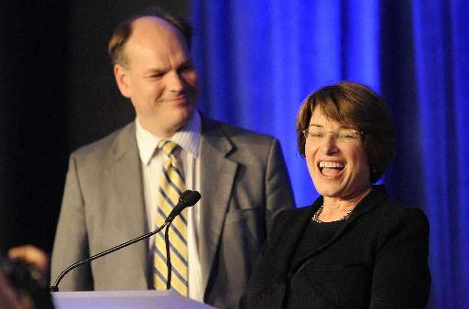 U.S. Senator from Minnesota Amy Klobuchar speaks at an election night event with husband after winning re-election. (AP  Photo/Hannah Foslien)