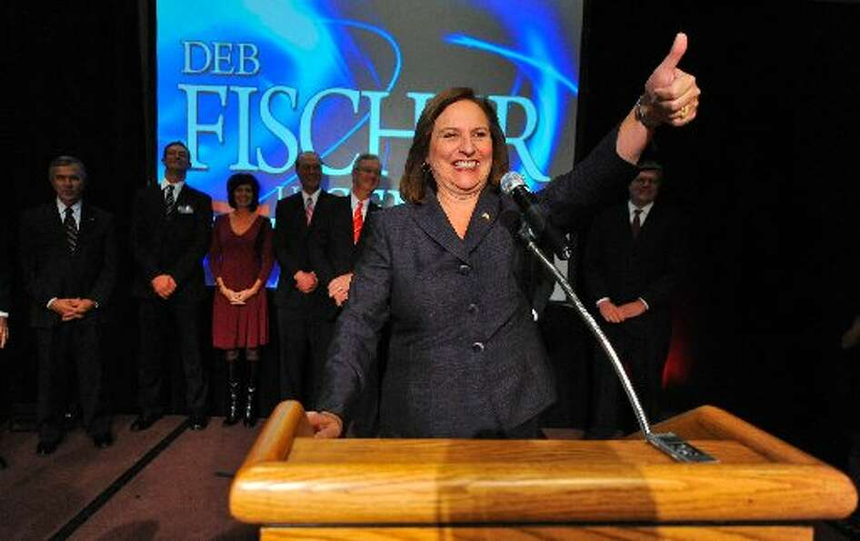 Nebraska Rep. Deb Fischer gives her supporters a thumbs up at a post-election party Tuesday. (AP Pho