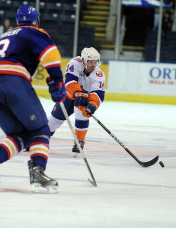 Bridgeport Sound Tigers' Matt Watkins controls the puck as Norfolk Admirals' Ryan Parent defends during their hockey game Wednesday, Nov. 7, 2012 at Webster Bank Arena in Bridgeport, Conn. Photo: Autumn Driscoll / Connecticut Post