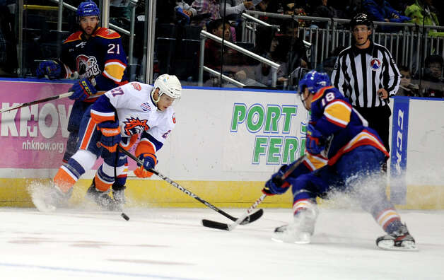 Bridgeport Aaron Ness and Norfolk Admirals' Chris Wagner battle for the puck during their hockey game Wednesday, Nov. 7, 2012 at Webster Bank Arena in Bridgeport, Conn. Photo: Autumn Driscoll / Connecticut Post