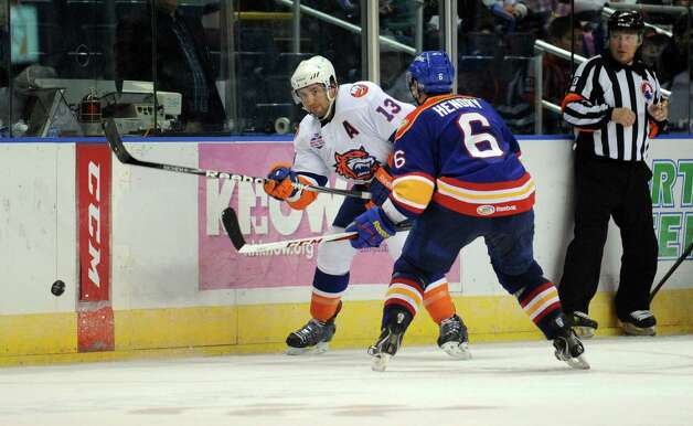 Bridgeport Sound Tigers' Colin McDonald passes the puck as Norfolk Admirals' Jordan Hendry defends during their hockey game Wednesday, Nov. 7, 2012 at Webster Bank Arena in Bridgeport, Conn. Photo: Autumn Driscoll / Connecticut Post