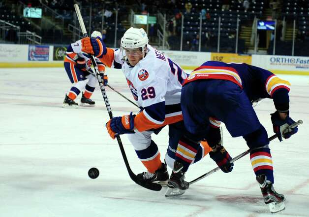 Bridgeport Sound Tigers' Brock Nelson wins the face off against Norfolk Admirals' Peter Holland during their hockey game Wednesday, Nov. 7, 2012 at Webster Bank Arena in Bridgeport, Conn. Photo: Autumn Driscoll / Connecticut Post