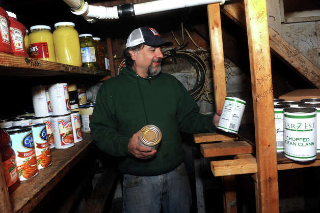 Owner Ed Colacurcio begins to restock the shelves in the basement of Bud's Deli, on Reef Road in Fairfield, Conn. Nov. 7th, 2012. The deli has been closed since it was flooded during storm Sandy, but Colacurio has cleaned up and hopes to be open this weekend. Photo: Ned Gerard