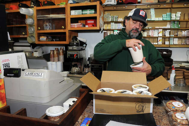 Owner Ed Colacurcio begins to restock the shelves at Bud's Deli, on Reef Road in Fairfield, Conn. Nov. 7th, 2012. The deli has been closed since it was flooded during storm Sandy, but Colacurio has cleaned up and hopes to be back open this weekend. Photo: Ned Gerard / Connecticut Post