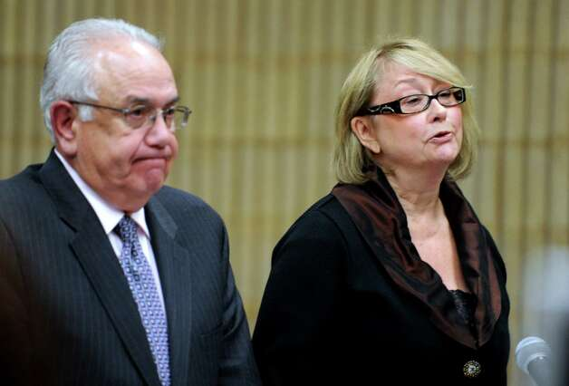 Former Oxford Tax Collector Karen Guillet stands beside her attorney Dominick Thomas during her sentencing Wednesday, Nov. 7, 2012 in state Superior Court in Milford, Conn.  Guillet, 63, pleaded guilty in July to a felony larceny charge for embezzling hundreds of thousands of dollars from the town while serving as tax collector. Photo: Autumn Driscoll / Connecticut Post
