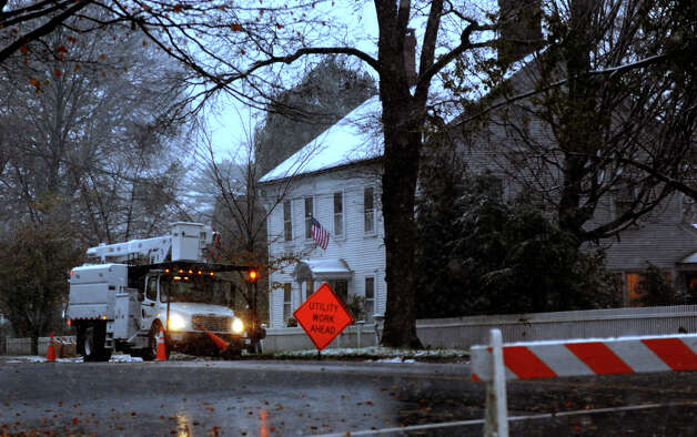 Power crews work to restore electricity to homes along Old Post Road in Fairfield, Conn. on Wednesday November 7, 2012. Photo: Christian Abraham / Connecticut Post