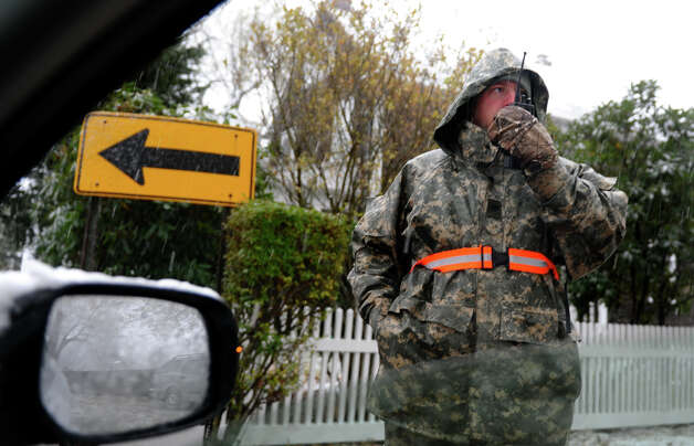 National Guardsman Specialist Tim Giunta mans a checkpoint on Beach Road in Fairfield, Conn. on Wednesday November 7, 2012. Photo: Christian Abraham / Connecticut Post