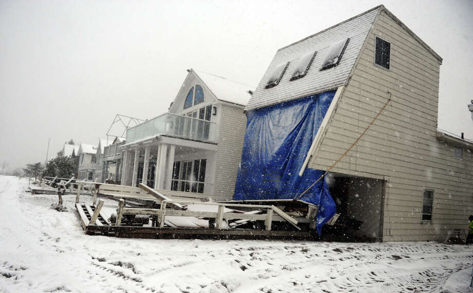 A damaged beach front home along Fairfield Beach Road in Fairfield, Conn. on Wednesday November 7, 2012. Photo: Christian Abraham / Connecticut Post