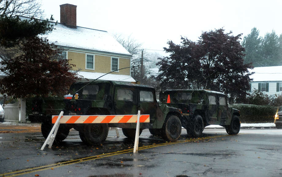 National Guard Humvees parked at a checkpoint along Beach Road in Fairfield, Conn. on Wednesday November 7, 2012. Photo: Christian Abraham / Connecticut Post