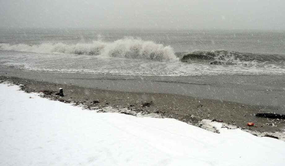 Choppy waves crash onto the beach along Fairfield Beach Road in Fairfield, Conn. on Wednesday November 7, 2012. Photo: Christian Abraham / Connecticut Post