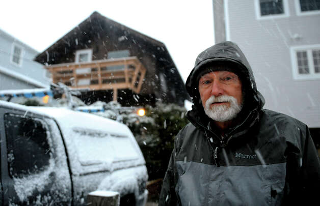 Resident Craig Thomas in front of a home he owns along Fairfield Beach Road in Fairfield, Conn. on Wednesday November 7, 2012. Photo: Christian Abraham / Connecticut Post