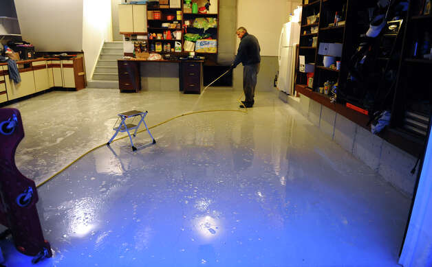 Handyman Joe Russo uses a power washer to clean a garage at a home along Fairfield Beach Road in Fairfield, Conn. on Wednesday November 7, 2012. Photo: Christian Abraham / Connecticut Post