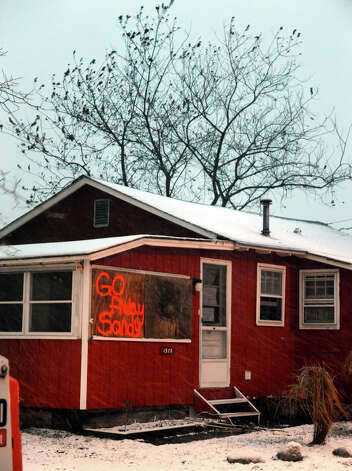 A meesage telling Hurricane Sandy to go away still adorns a wall of a home along Fairfield Beach Road in Fairfield, Conn. on Wednesday November 7, 2012. Photo: Christian Abraham / Connecticut Post