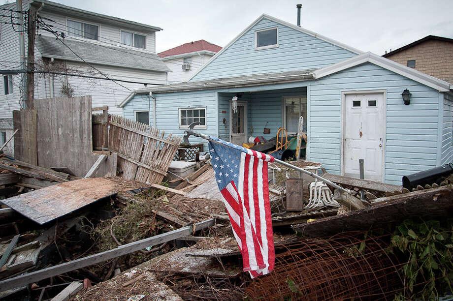 Scenes of devastation in Gerritsen Beach. (Adrian Kinloch / Flickr)