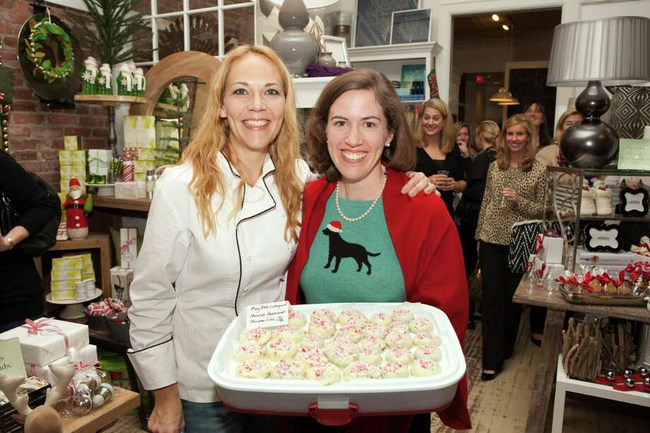 The YWCA Darien/Norwalk will host its annual Cookies, Cocktails and a Cause Ladies Night Thursday, Dec. 6, at 7:30 p.m. at NielsenâÄôs Florist. Above, cookie judge Lori Gilmore of Good Food, Good Things, and contest winner Mary Beth Livengood. Photo: Contributed Photo