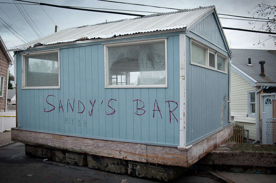 """Sandy's Bar"" washed up in Gerritsen Beach from a nearby marina. (Adrian Kinloch / Flickr)"